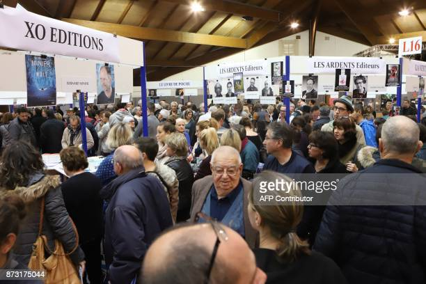 People visit the 36th edition of the 'Foire du Livre de Brive' book fair on November 12 2017 in BrivelaGaillarde southwestern France / AFP PHOTO /...
