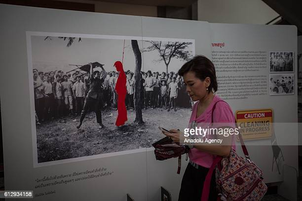 People visit the 40th anniversary memorial exhibition inside the Thammasat University Campus as Thailand marks the 40th anniversary of the Thammasat...