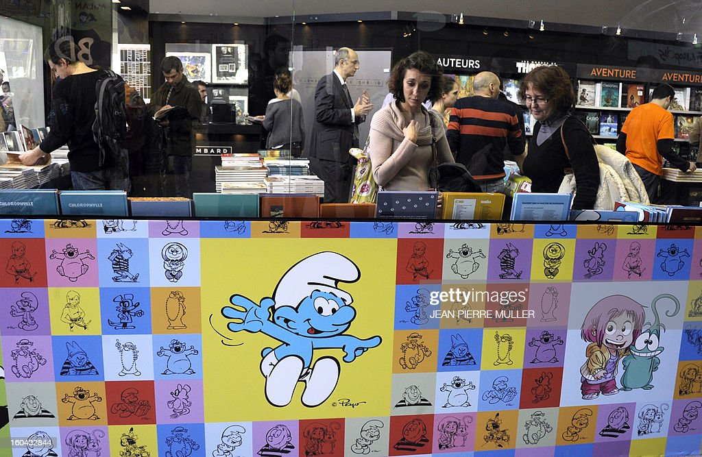 People visit the 40th International Comic book festival of Angouleme on January 31, 2013.