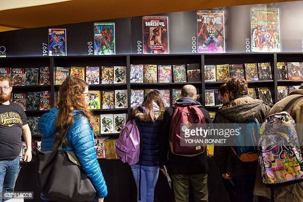 People visit the 44th international comic book festival on January 28 2017 in Angouleme / AFP / Yohan BONNET
