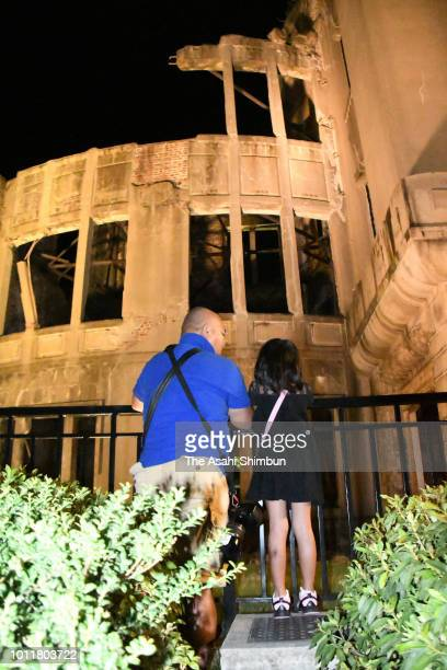 People visit the ABomb Dome prior to the Peace Memorial Ceremony at the Peace Memorial Park on the 73rd anniversary of the Hiroshima ABomb dropping...