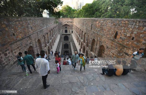 People visit the Agrasen ki Baoli, on Hailey Road, near Connaught Place on October 13, 2019 in New Delhi, India. Designated a protected monument by...
