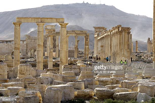 People visit the ancient historical site of Syria's ravaged Palmyra on May 6 2016 following its recapture by regime forces from the Islamic State...