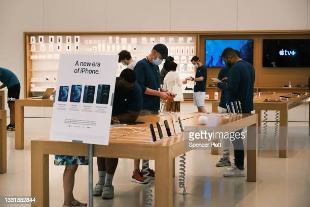 People visit the Apple store in the Oculus Mall in Manhattan on July 29, 2021 in New York City. Numerous stores in the mall, including the Apple...