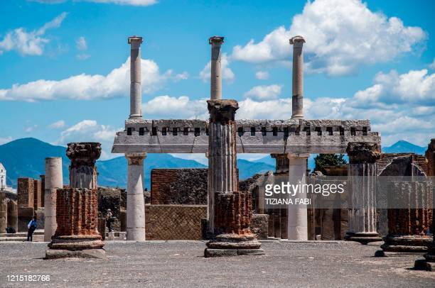 People visit the archeological site of Pompeii on May 26 as the country eases its lockdown aimed at curbing the spread of the COVID-19 infection,...