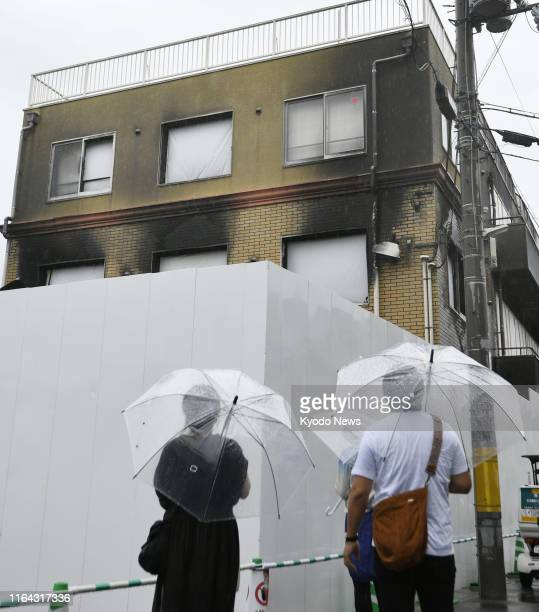 People visit the arson attack-hit studio of Kyoto Animation Co. In Kyoto, western Japan, on Aug. 27, 2019. Police the same day completed the process...