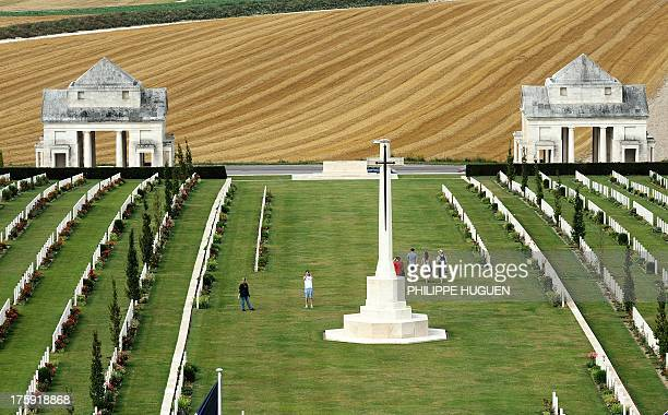 People visit the Australian cemetery of VillersBretonneux World War I memorial on August 102013 in Villers Bretonneux AFP PHOTO PHILIPPE HUGUEN
