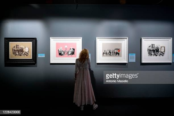 People visit the Banksy's Visual Protest Exhibition at the Chiostro del Bramante on September 9 in Rome Italy Rome celebrates street artist Banksy...