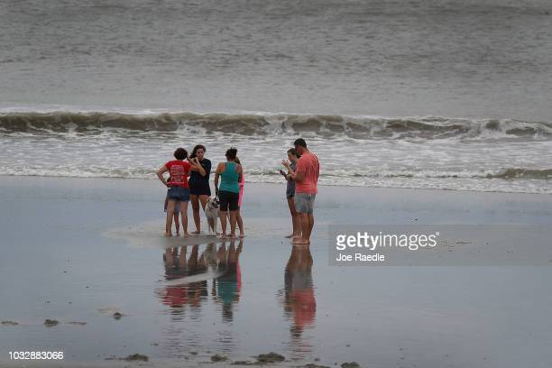 People visit the beach as they await the arrival of Hurricane Florence on September 13 2018 in Myrtle Beach South Carolina Hurricane Florence is...