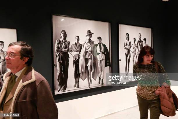 People visit the Big Nudes section of the Helmut Newton pictures exibition in PAN Art's palace in Naples on February 24 2017