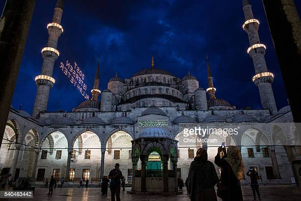 People visit the Blue Mosque for evening prayer during the holy month of Ramadan on June 14 2016 in Istanbul Turkey The holy month of Ramadan is...