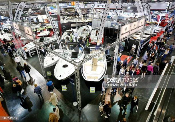 People visit the 'Boot Dusseldorf' international fair dedicated to boats and watersports on January 20 2018 in Duesseldorf The event runs until...