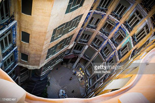 People visit the building 'La Pedrera' or 'Casa Mila' of Antoni Gaudi on July 24 2013 in Barcelona Spain Foreign visitors to Spain set a new record...