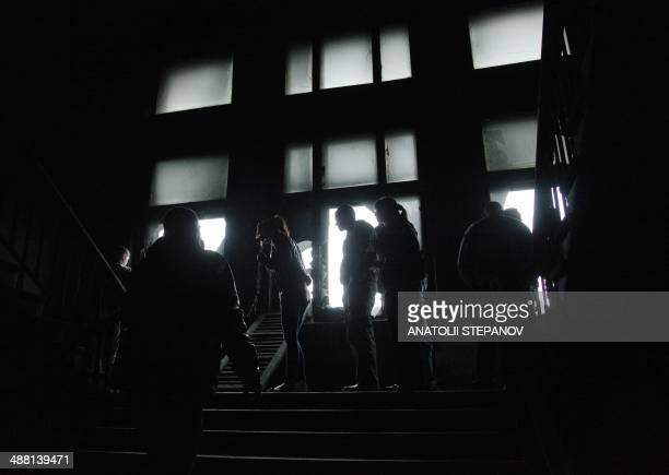 People visit the burned trade union building in the southern Ukranian city of Odessa on May 4, 2014. Flowers, candles and photos of the dead pile up...