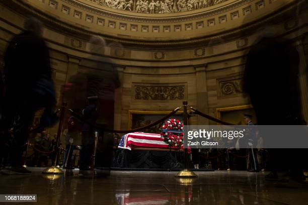 People visit the Capitol Building as former US President George HW Bush lies in State on December 3 2018 in Washington DC A WWII combat veteran Bush...