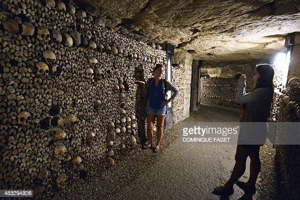 People visit the Catacombs of Paris which hold over six million skulls and bones These underground quarries were used to store the remains of...