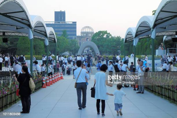People visit the cenotaph prior to the Peace Memorial Ceremony at Hiroshima Peace Memorial Park on the 73rd anniversary of the Hiroshima ABomb...