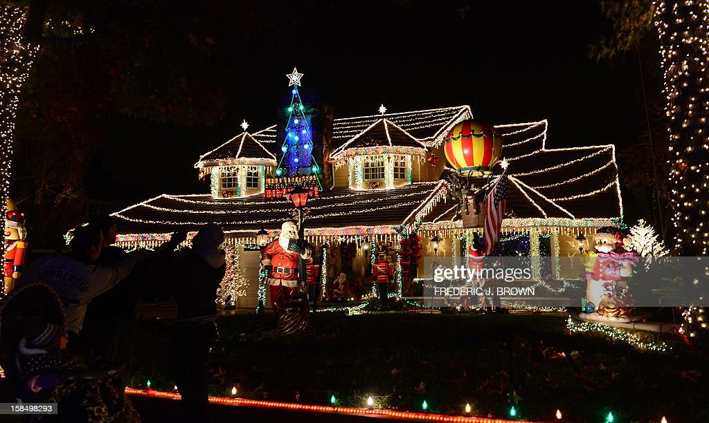 people visit the christmas light decorations along thoroughbred lane in rancho cucamonga forty plus miles
