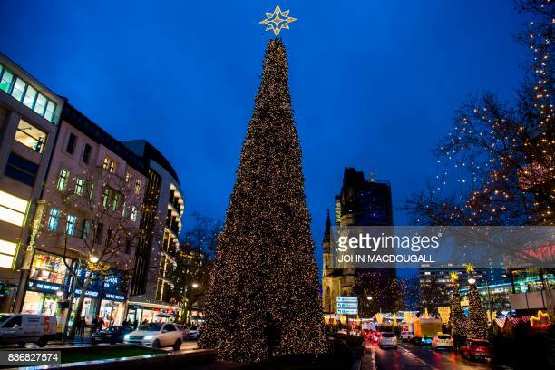People visit the Christmas market at Breitscheidplatz in western Berlin's main shopping district ahead of the Christmas holidays on December 5 2017 /...