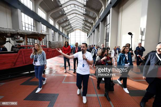 People visit the Cite du Cinema in SaintDenis on May 15 where the Olympic Village is planned to be installed as the IOC Evaluation Commission...