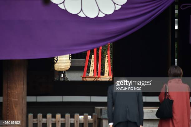 People visit the controversial Yasukuni shrine during the shrine's autumn festival in Tokyo on October 17 2015 Japan's Prime Minister Shinzo Abe...