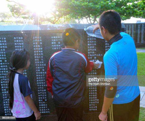 People visit the Cornerstone of Peace where the names of their bereaved family members and relatives engraved at the Peace Memorial Park on the 73rd...
