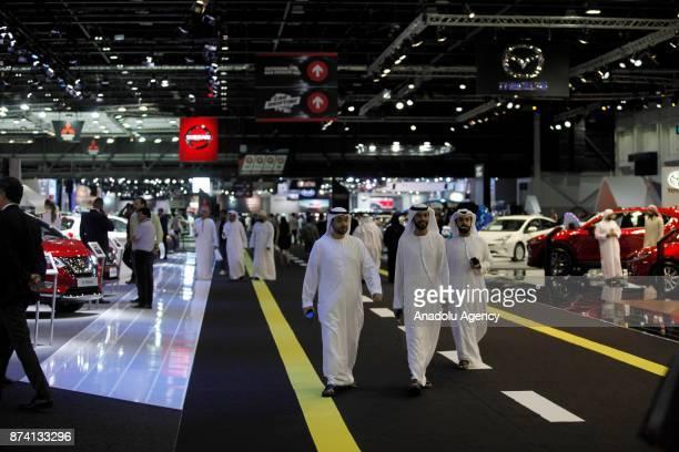People visit the Dubai International Motor Show 2017 at Dubai World Trade Centre in Dubai United Arab Emirates on November 14 2017