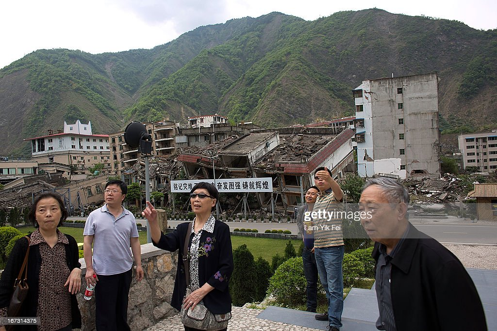 People visit the earthquake memorial park at the Beichuan town in Sichuan province on April 24, 2013 in Chengdu, China. The Beichuan earthquake memorial was built in memory of the over 70,000 that perished in the deadly 2008 quake that struck Sichuan province and was built near the Beichuan Middle School, where over 1,000 students and teachers died. With the five year quake anniversary only a few weeks away, residents of Sichuan province are coming to grips with the April 20 earthquake in nearby Ya'An that claimed the lives of over 190 people and injured thousands.