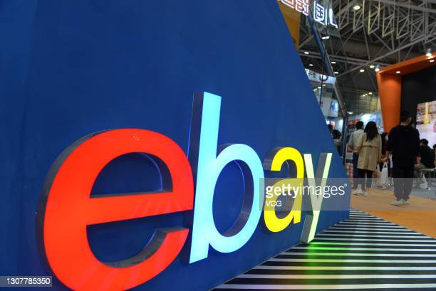 People visit the eBay booth during the first China Cross-border E-commerce Trade Fair at Fuzhou Strait International Conference and Exhibition Center...