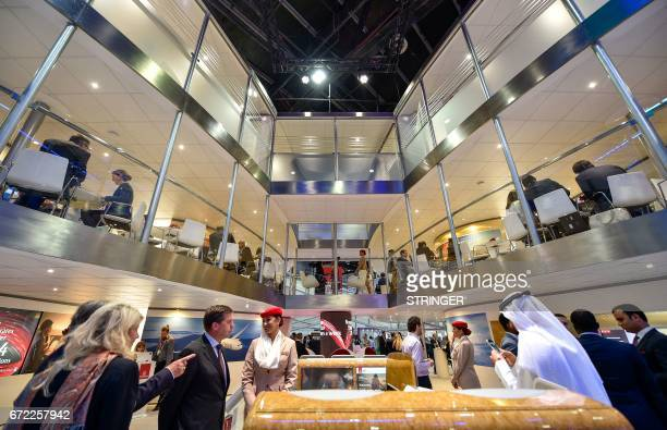 People visit the Emirate Airways stand during the Arabian Travel Market 2017 at the Dubai World Trade Centre on April 24 2017 / AFP PHOTO / Stringer