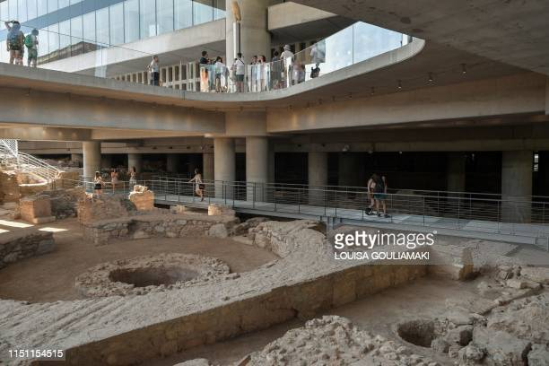 People visit the excavation beneath the Acropolis museum in Athens, on its opening day on June 21, 2019 which coincidences with the ten years...