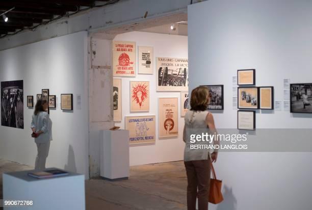 People visit the exhibition '1968 quelle histoire ' as part of the photography festival 'Les Rencontres de la photographie Arles 2018' in Arles...