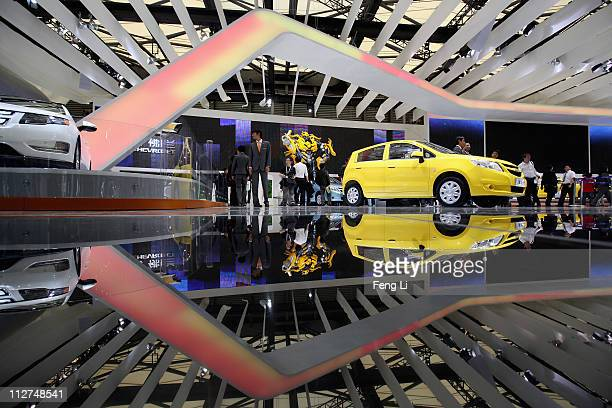 People visit the exhibition area of the Chevrolet during the media day of the Shanghai International Automobile Industry Exhibition at Shanghai New...