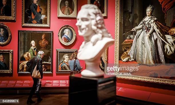 People visit the exhibition 'Catherine the Great' during a press preview at the Hermitage Museum in Amsterdam on June 17 2016 / AFP / ANP / Remko de...