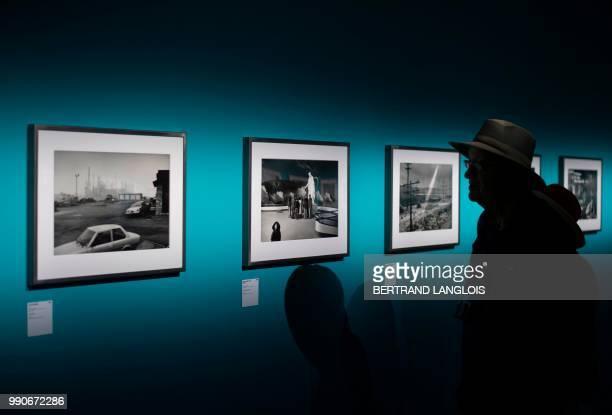 People visit the exhibition 'Depardon USA 19681999' by French photographer Raymond Depardon as part of the photography festival 'Les Rencontres de la...