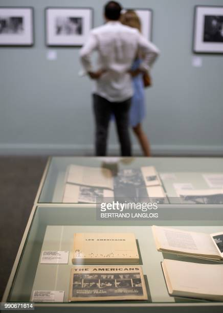 People visit the exhibition 'Sidelines' by Swiss photographer Robert Frank as part of the photography festival 'Les Rencontres de la photographie...