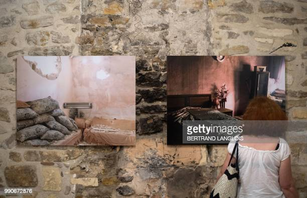 People visit the exhibition 'Une colonne de fumee' focusing on Turkish contemporary photography as part of the photography festival 'Les Rencontres...