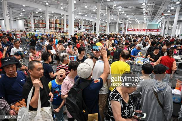 TOPSHOT People visit the first Costco outlet in China on the stores opening day in Shanghai on August 27 2019 China has proved a brutal battleground...