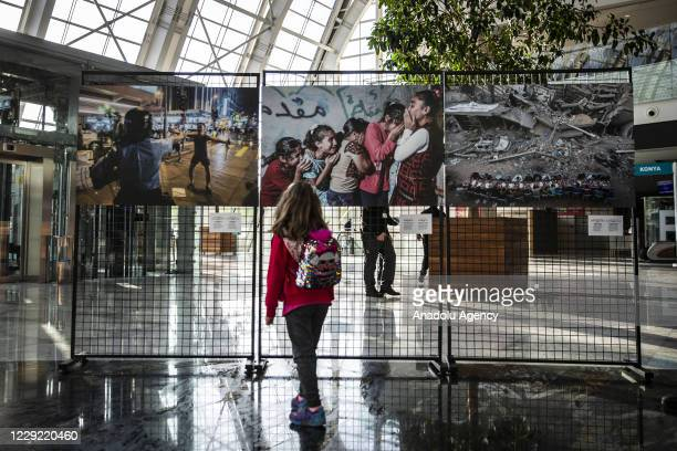 People visit the first exhibition of Istanbul Photo Awards 2020, which is Anadolu Agency's sixth international news photography contest, with the...