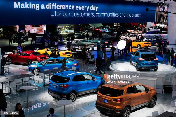 People visit the Ford stand during the press preview at the 2018 North American International Auto Show in Detroit Michigan on January 16 2018 Car...