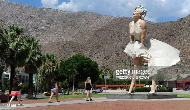 People visit the 'Forever Marilyn' statue of actress Marilyn Monroe in Palm Springs California on August 4 a day ahead of the 50th anniversary of...