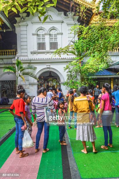 people visit the gangaramaya temple, colombo, sri lanka. - imagebook stock pictures, royalty-free photos & images