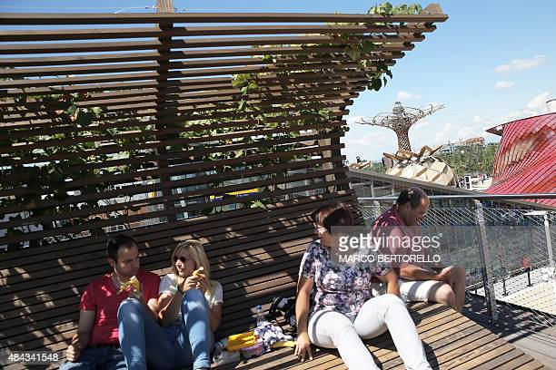 People visit the German pavilion at the Universal exhibition Expo Milano 2015 on August 17 2015 in Milan AFP PHOTO / MARCO BERTORELLO