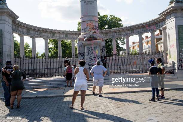 People visit the graffiticovered monument to Confederate President Jefferson Davis on June 14 2020 at Monument Avenue in Richmond Virginia The statue...