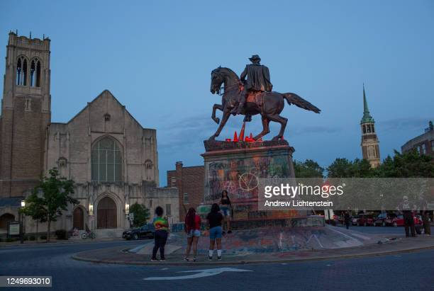 People visit the graffiticovered statue of Confederate General JEB Stuart on June 14 2020 at Monument Avenue in Richmond Virginia The killing of...