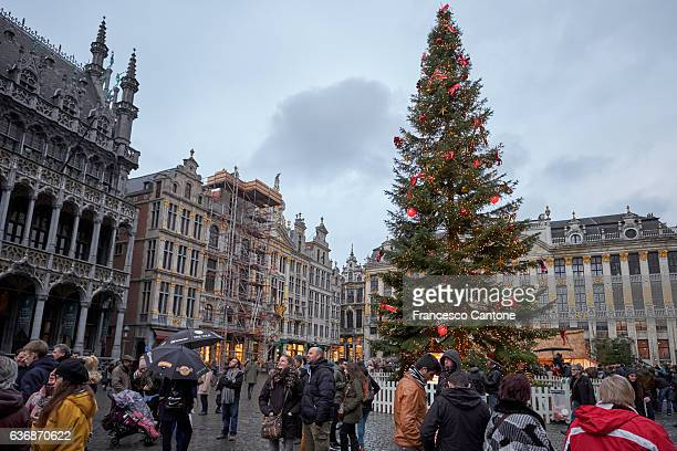 people visit the grand place or grote markt - brussels capital region stock photos and pictures