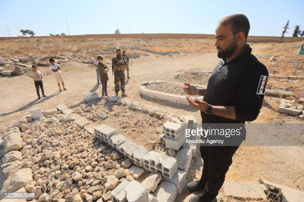 People visit the graves before an event to mark the first year of Operation Peace Spring as life turned to normal in Tal Abyad Syria on October 13...