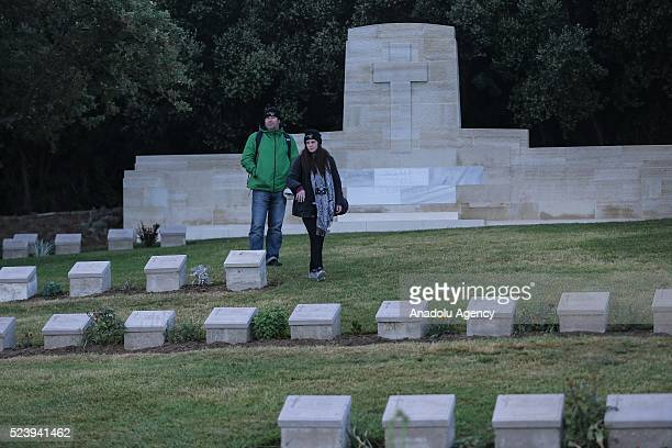 People visit the graves of Anzac soldiers following the Anzac dawn service at Anzac Cove in commemoration of the 101st anniversary of Canakkale Land...