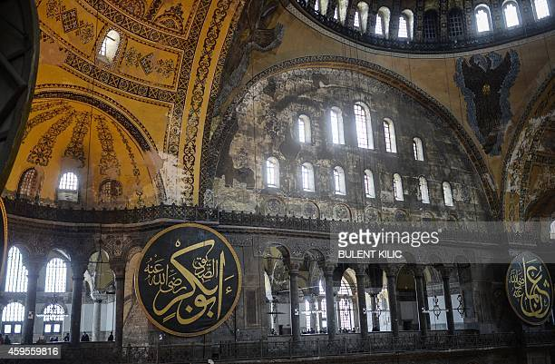 People visit the Hagia Sophia in Istanbul on November 25 2014 Pope Francis will visit Turkey on November 2830 eight years after his predecessor...