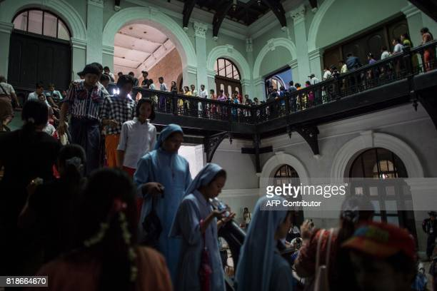 People visit the historic Secretariat building in Yangon on July 19 on the 70th anniversary when Myanmar independence hero General Aung San and eight...